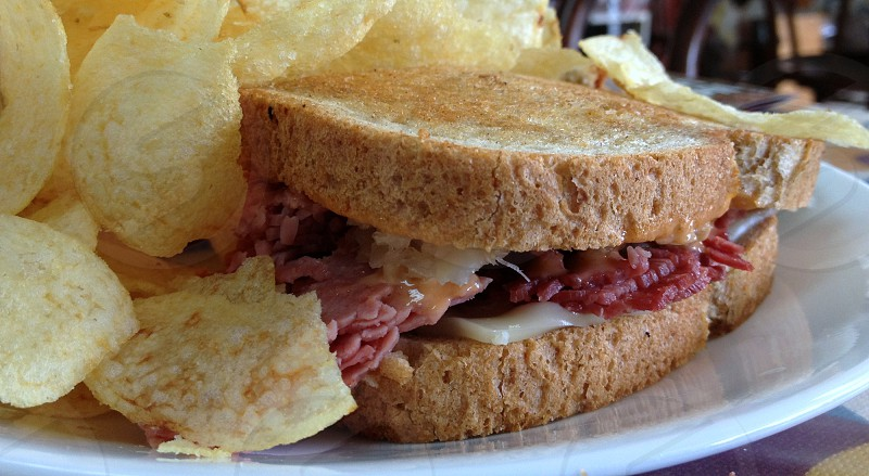 Reuben sandwich with potato chips photo