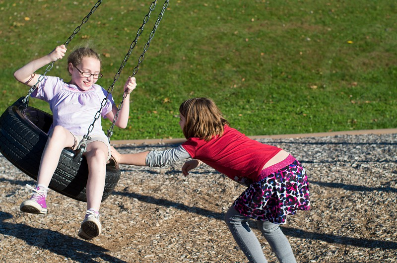 kids on swing at park photo