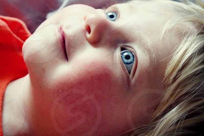 Bright blue eyed baby toddler close up. photo