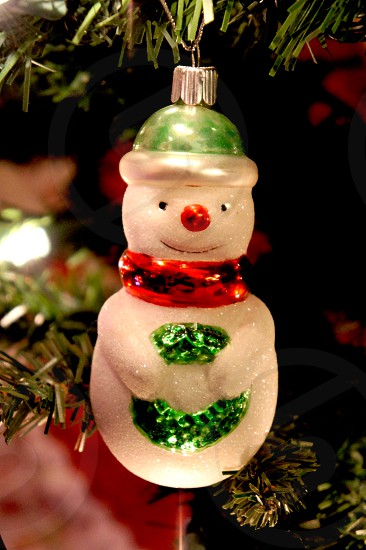 Snowman holiday ornament on a Christmas tree photo