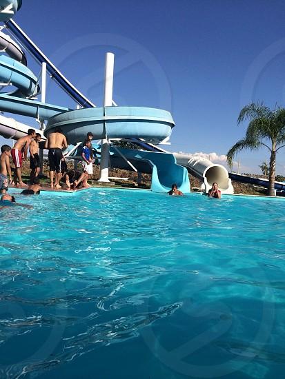 people swimming in pool photo