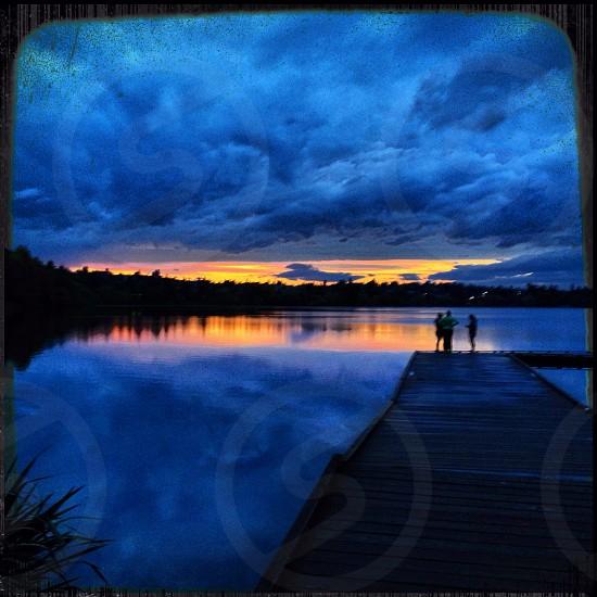 people standing on dock high range dynamic photography photo