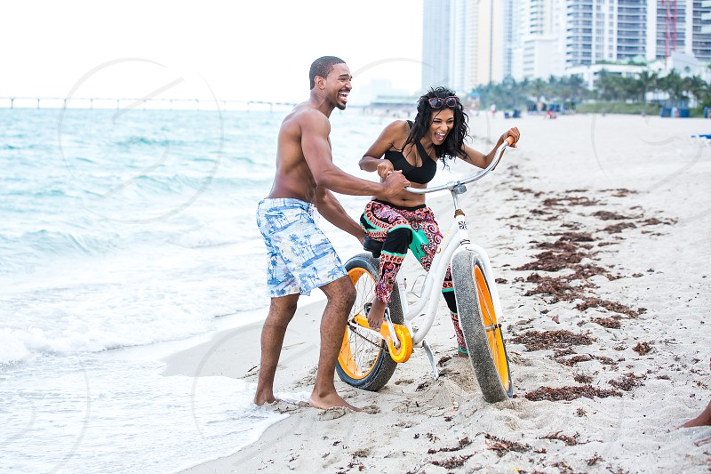 Newlyweds on Honeymoon beautiful African American couple Miami Sunny Isles Beach photo