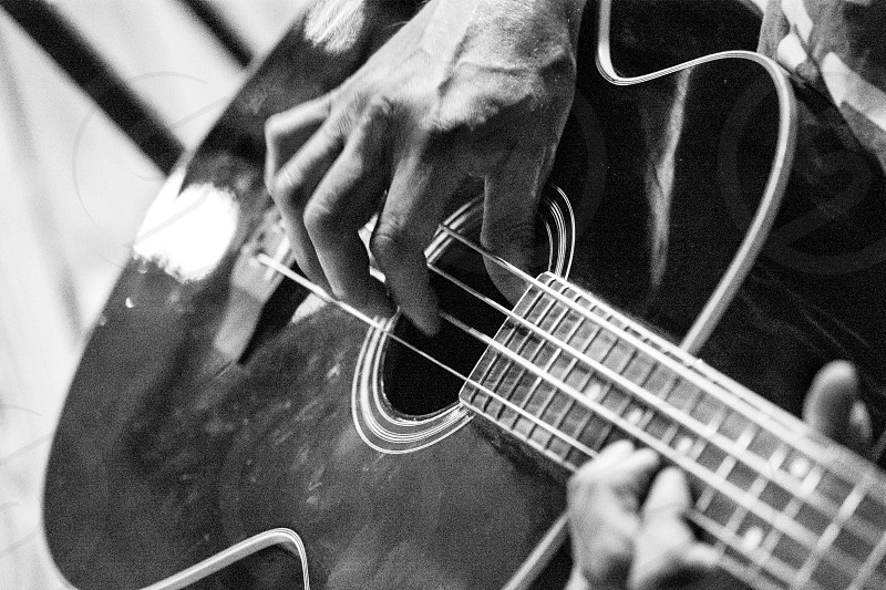 Reactions Speak Louder Than Words emotive imagery communicate inspiration delight black and white B&W grain high iso emotions Fearlessness Creativity Craftsmanship Innovation Bold Authentic guitar hand play music fingers photo