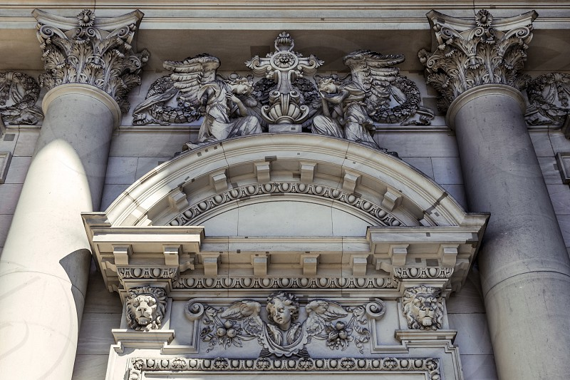 A close-up exterior view on a sculptural composition above the entrance of Dom Berliner also known as the Berlin Cathedral in the historic city of Berlin in Germany. photo