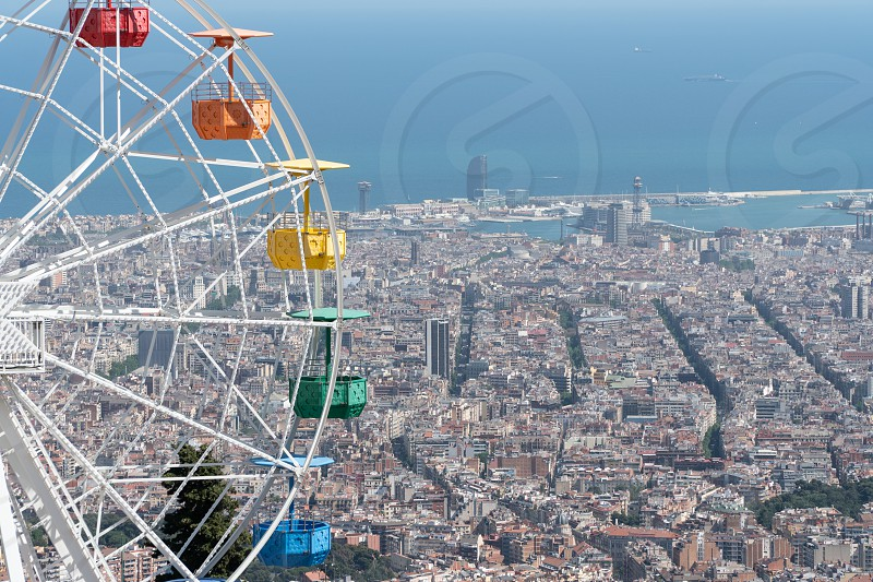 Ferris Wheel at Tibidabo amusement park in Barcelona with city view at the background photo