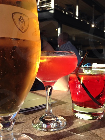 Three drinks lined up alcohol bar photo