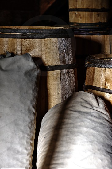 Old wooden barrels and bags photo