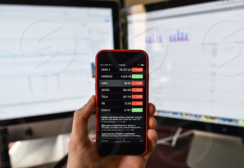 stocks phone technology trader data charts money finance photo