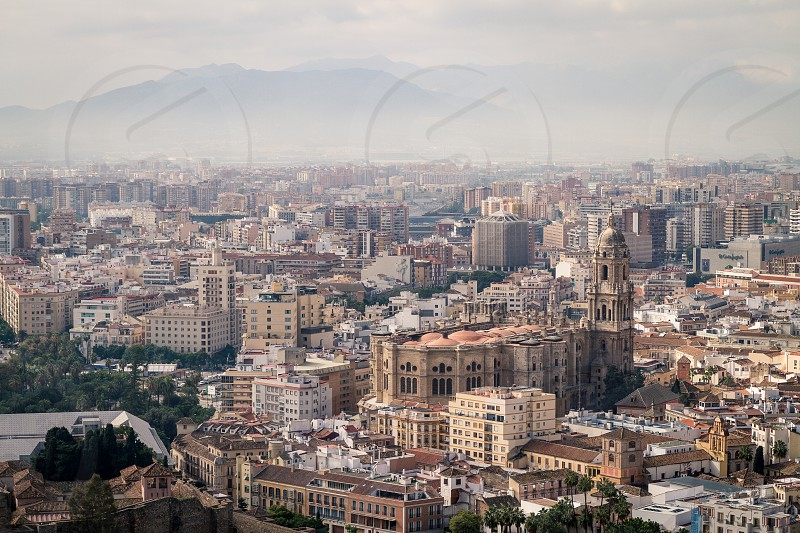 landscape city mountains travel church buildings old urban architecture cityscape building symbol panorama skyline cathedral streets landmark medieval metropolitan block crowded municipal populous Spain Europe Andalucia Andalusia Malaga photo