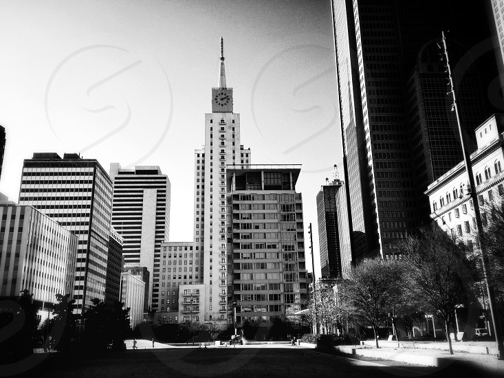 gray scale photo of white high rise building photo
