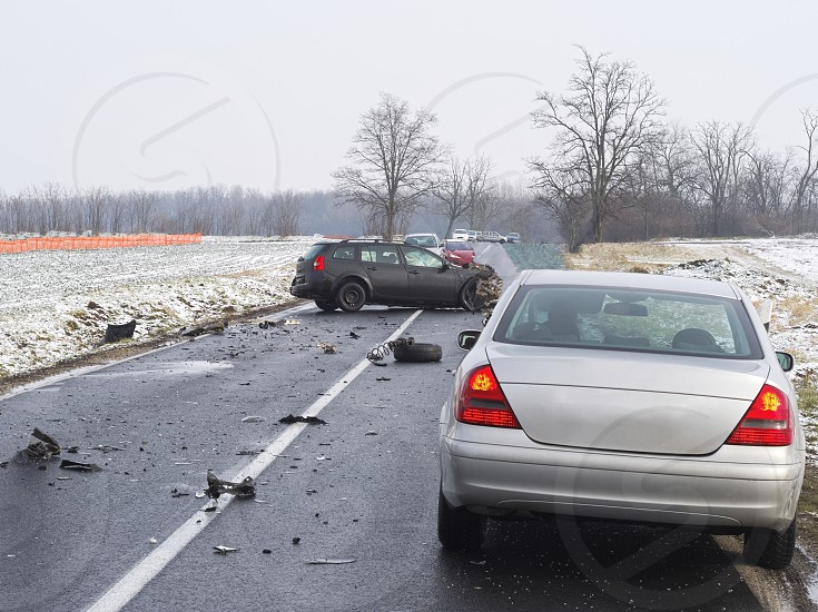 Damaged Cars and Debris on the Wet Road on a Winter Day photo