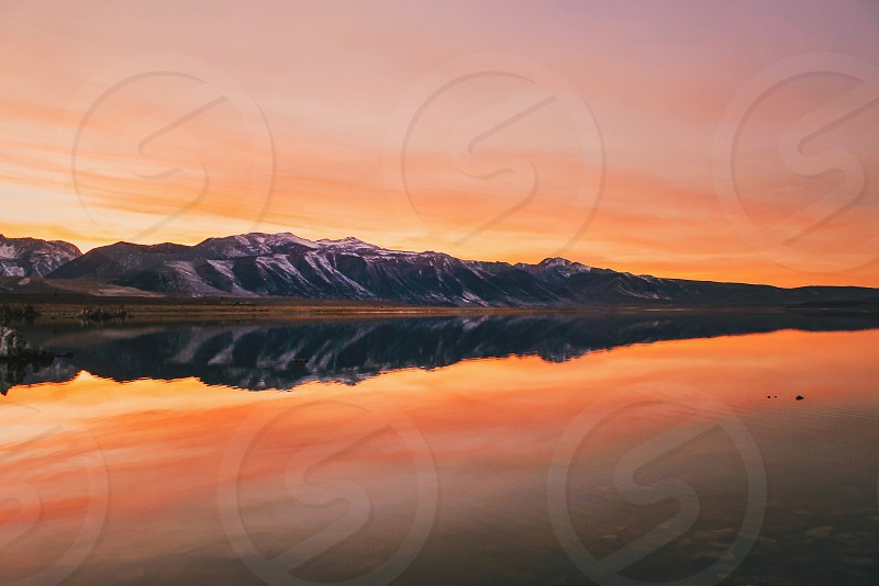 sunset orange red mountains lake water reflection  photo