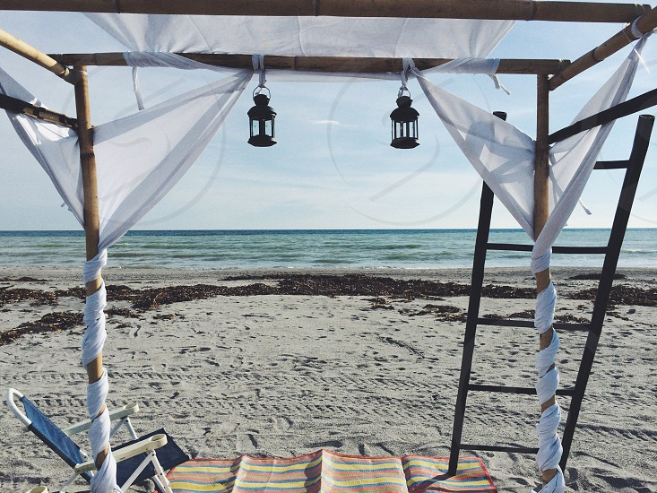 Beach cabana sand sea proposal engagement photo