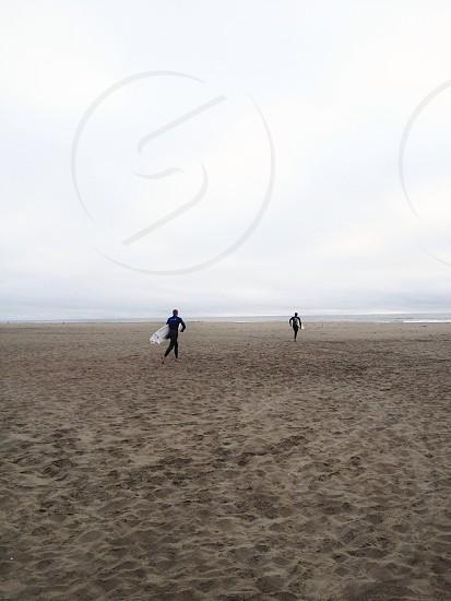 men white surf board photo