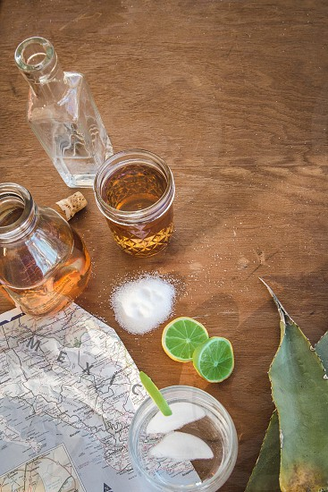 tequila salt and lime on wooden table photo