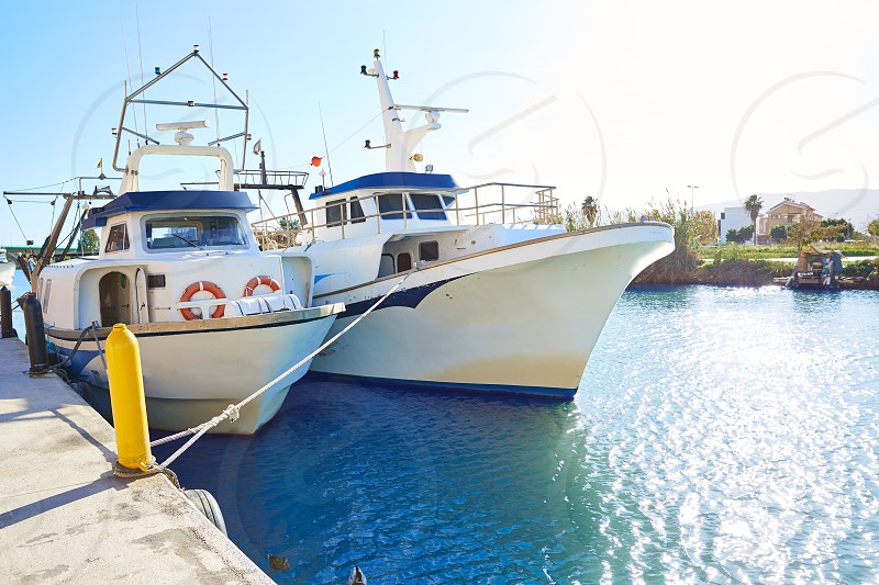 Cullera fisherboats port in Xuquer Jucar river of Valencia Spain photo
