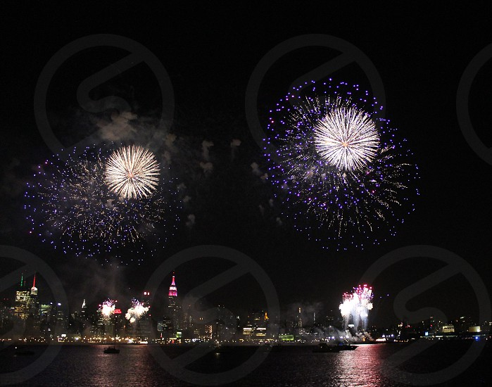 New York. 4th of July fireworks. Manhattan in the background. photo