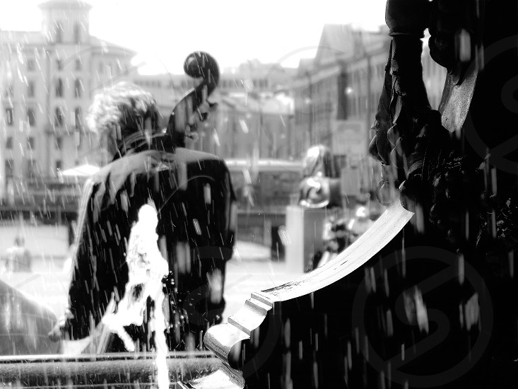 Music musician bass bassplayer city  cityview street streetview bw  monochrome statue water BW fountain  stone black man people architecture  buildings Sweden  photo