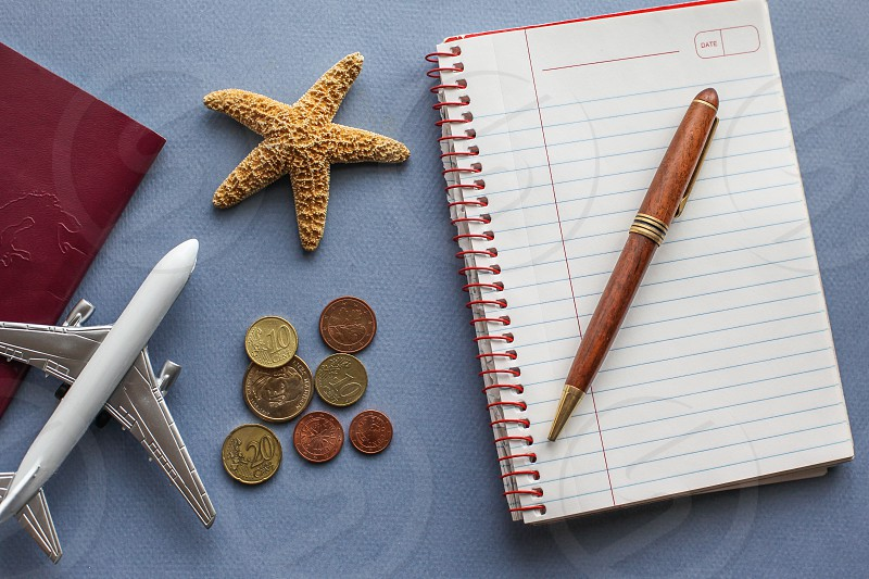 Travel background concept with airplane and notes photo
