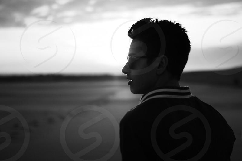 silhouette on man wearing sunglasses photo