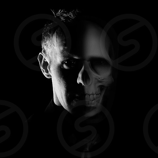 man face with half skull photo
