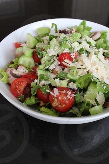 Salad cheese tomatoes cucumbersParmesan fresh vegetables photo