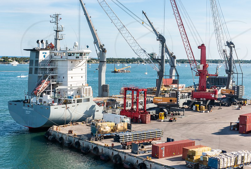 Small maritime vessel loading at Port of Palm Beach photo