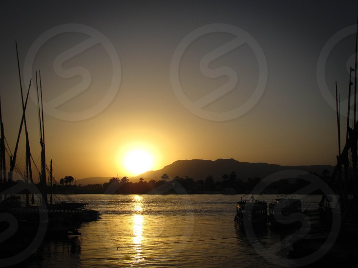 River boats sun sunset photo