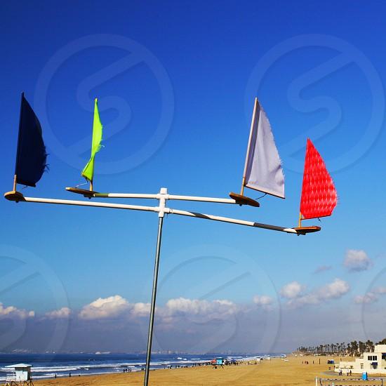 Airport wind flags near the ocean photo