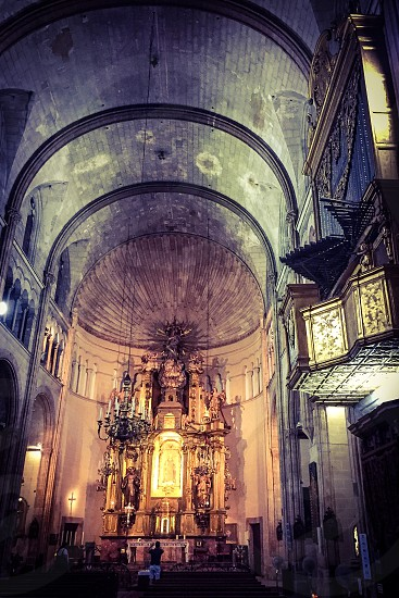 grey cathedral with white candelabras photo