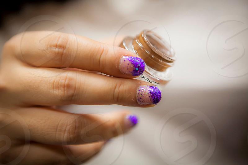 woman in purple glittered manicure photo