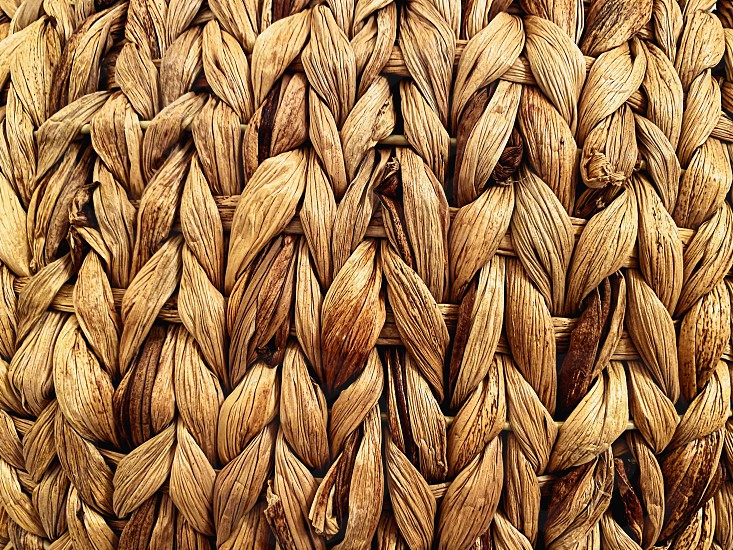 close-up view of a straw basket. Detail on the lines. Handmade product. Texture effect. Retro furniture and decorations photo