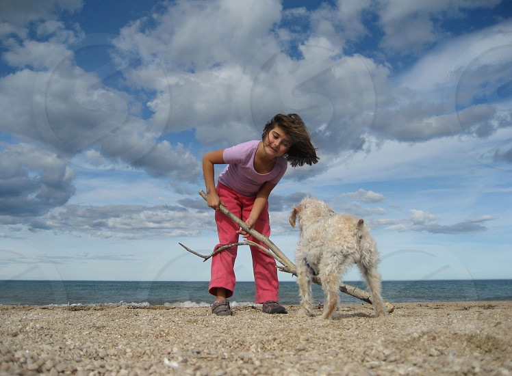 Girls with dog at the beach  photo