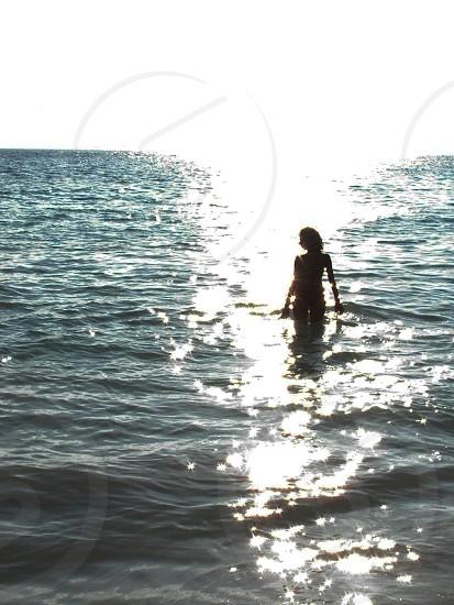 Female silhouette at the beach. photo