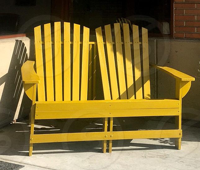 Bright  yellow Adirondack chairs in the sunlight photo