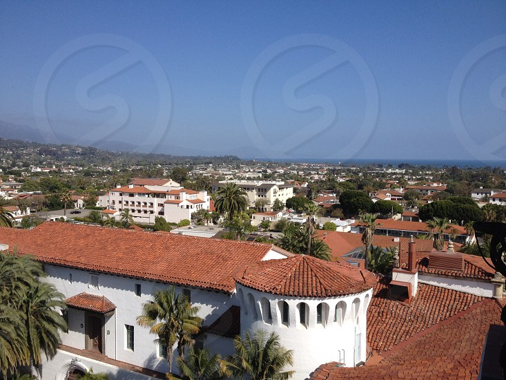 red roof tiles and white buildings photo