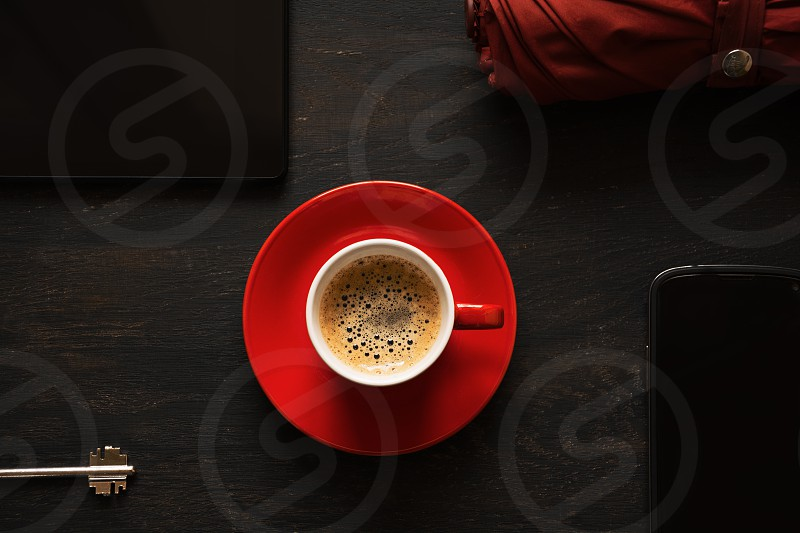 Morning coffee umbrella smartphone tablet and key photo
