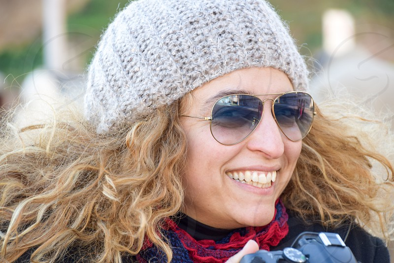 Beautiful Happy Smiling Woman Wearing Sunglasses And Cap photo