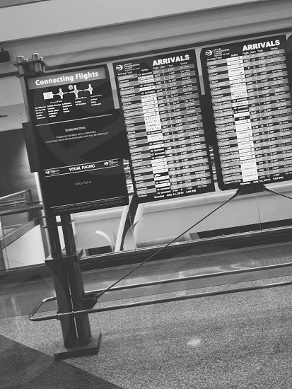 connecting flights arrivals board in an airport photo