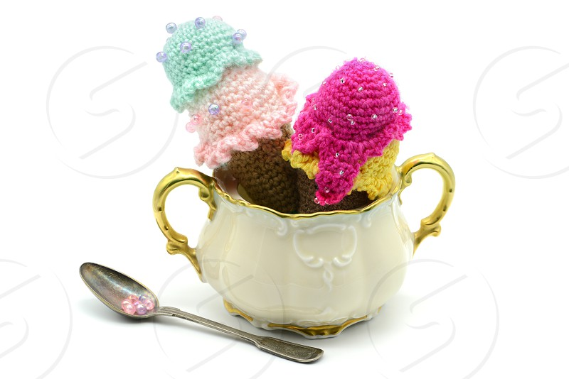 crochet ice cream cone of wool on a sugar box. white isolated background photo