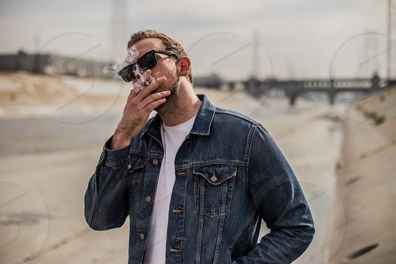 Man smoking in LA River photo