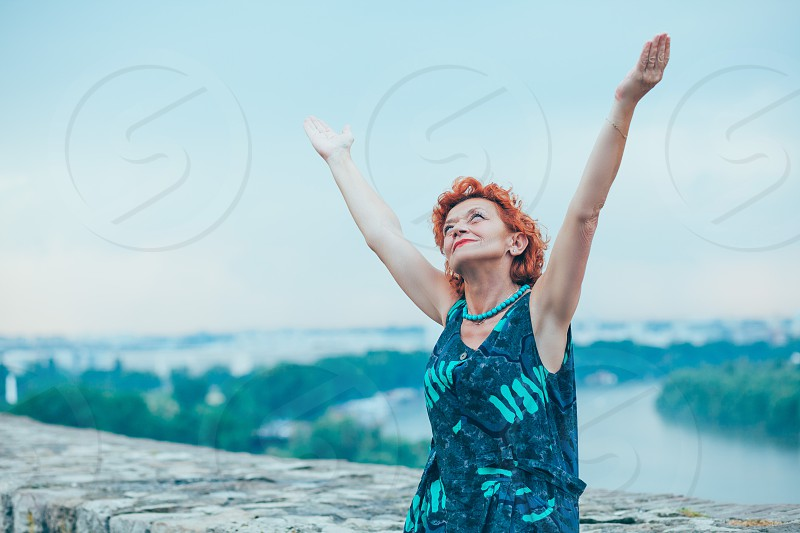 Older women reaching to the sky miracle photo