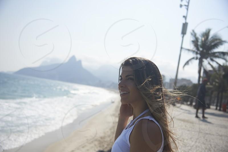 Portrait of  beautiful happy Brazilian woman in a white bikini top on the beaches in Rio de Janeiro photo
