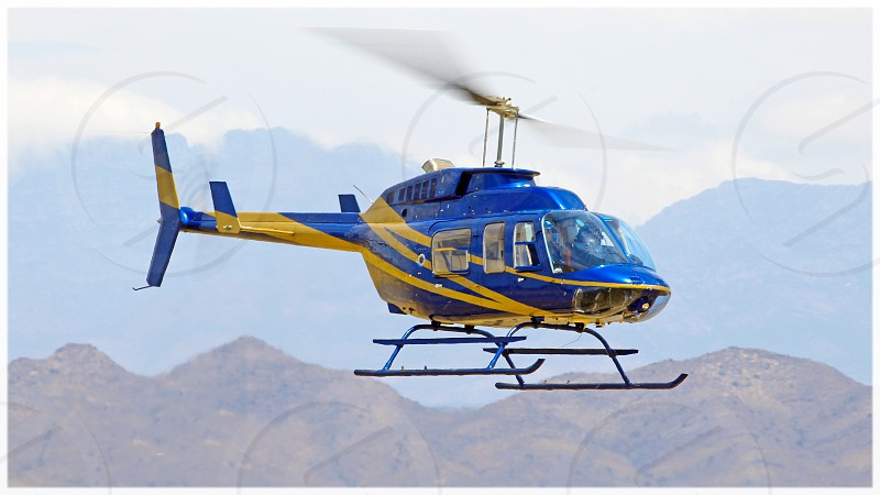 Bell bell helicopter bell jetranger aviation flight school helicopter rotor wing blue pilot corporate commercial scenery landscape photo