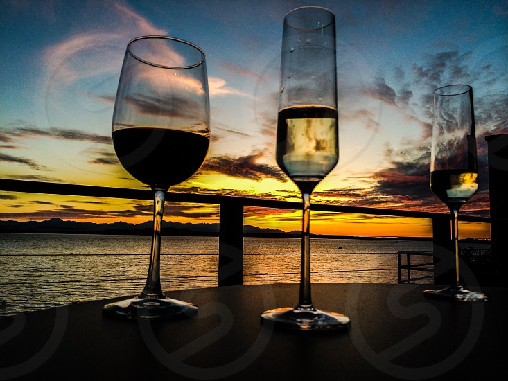 Sunset west Seattle wine champaign dinner party deck Puget sound Olympic mountains  photo
