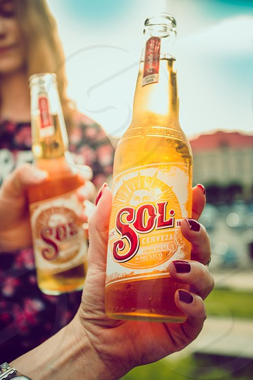 Lublin / Poland - May 25 2018: Friends spending time together outdoors in the center of town having fun and enjoying the Sol beer photo