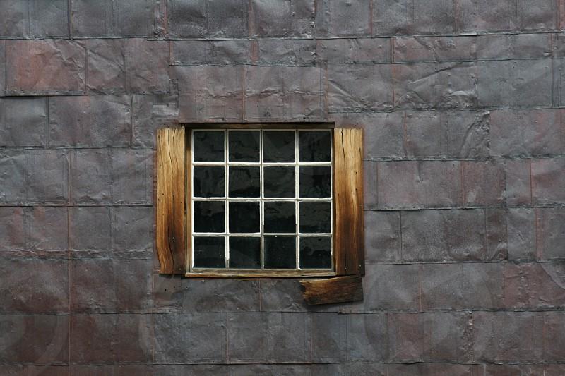 window on old metal building photo