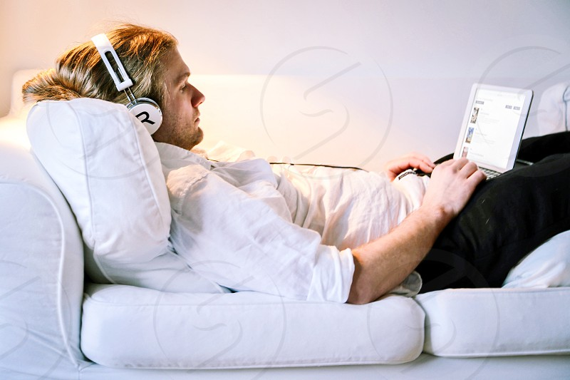 Sofa couch  man relaxing apartment  room music headphones earphones  techno  device profile photo