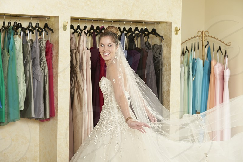 Bride trying on a wedding dress photo